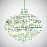 Julstruntsak som göras från glad jul i olika språk Arkivfoto