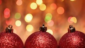 Julstruntsaker mot oskarpa ljus arkivfilmer
