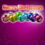 Julstruntsaker på en violett backgroun Royaltyfri Fotografi