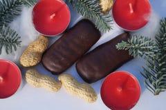 Jultabellgarnering med stearinljuset och gran Royaltyfria Bilder