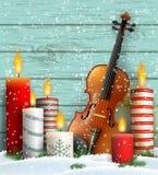 Jultema med fiolen och brinnande stearinljus stock illustrationer