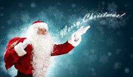 Jultema med santa Royaltyfria Bilder