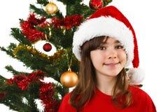 Jultid - flicka med den Santa Claus hatten Royaltyfri Foto