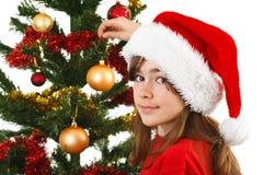 Jultid - flicka med den Santa Claus hatten Arkivfoto