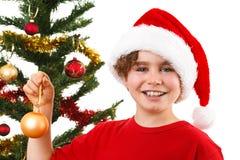 Jultid - pojke med Santa Claus Hat Arkivbilder