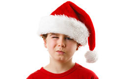 Jultid - pojke med Santa Claus Hat Royaltyfria Bilder