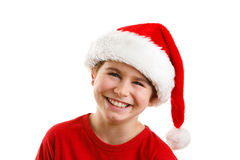 Jultid - pojke med Santa Claus Hat Royaltyfria Foton