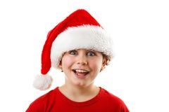 Jultid - pojke med Santa Claus Hat Arkivbild