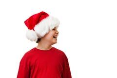 Jultid - pojke med Santa Claus Hat Fotografering för Bildbyråer