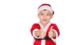 Jultid - pojke med Santa Claus Hat Ung pojke som Santa Cl Royaltyfria Bilder