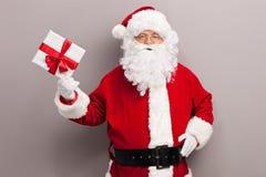 Jultomte innehav per gåva Arkivfoto