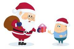 Jultomte och pojke Arkivfoto
