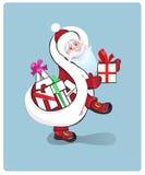 Jultomte som mycket bär säcken av gåvor Royaltyfri Foto
