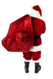 Jultomten: Bakre sikt av Santa Holding Gift Sack Royaltyfri Foto