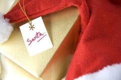 Jultomten card på gåvaasken Fotografering för Bildbyråer