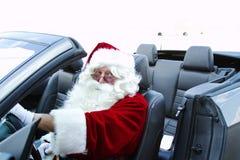 Jultomten i cabriolet Royaltyfria Bilder