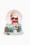 Jultomten i en crystal vattenboll Arkivfoto