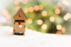 Jultomten i ett uthus på snö över och abstrakt bakgrund Fotografering för Bildbyråer