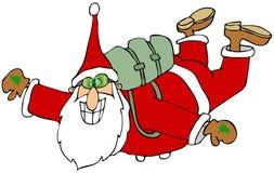 Jultomten i fritt fall Arkivbild