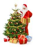 Jultomten i handling Fotografering för Bildbyråer