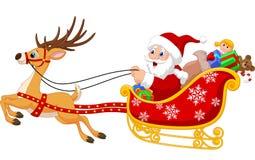 Jultomten i hans julsläde som dras av renen Royaltyfria Bilder