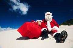 Jultomten kan slutligen koppla av Royaltyfria Bilder