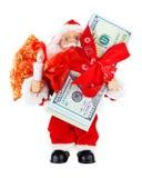 Jultomten med bunten av dollar Arkivbilder