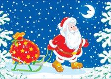 Jultomten med en gåvapåse Royaltyfria Bilder