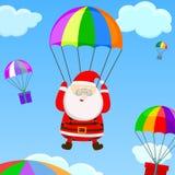 Jultomten med en hoppa fallskärm Fotografering för Bildbyråer