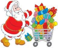 Jultomten med en shoppingvagn av gåvor Arkivfoton