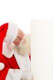 Jultomten med ett tecken till sidan Arkivbilder