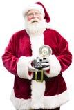 Jultomten med tappningkameran Arkivbilder