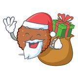 Jultomten med tecknade filmen för maskot för gåvachoklad den ljusbruna stock illustrationer