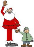 Jultomten och en liten pojke Royaltyfri Foto