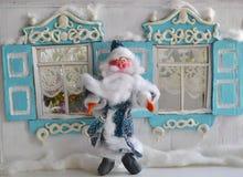 Jultomten och hans hem Arkivfoto