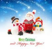 Jultomten och snögubbear Royaltyfri Foto