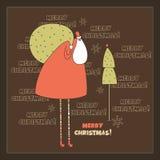 Jultomten och trädet. Arkivbild