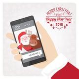 Jultomten smartphone Royaltyfri Bild