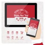 Jultomten smartphone och minnestavla Royaltyfri Bild