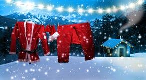 Jultomten som beklär att hänga på en klädstreck stock illustrationer