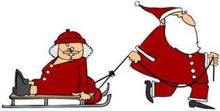 Jultomten som drar fru Claus på en släde stock illustrationer