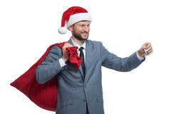 Jultomten som ger tangent i gåva av lägenheten, huset eller bilen Royaltyfri Fotografi