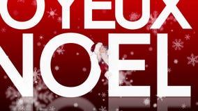 Jultomten som kikar runt om joyeuxnoel på festlig bakgrund arkivfilmer