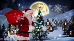 Jultomten som levererar gåvor till julbyn stock video