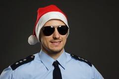 Jultomten som polis arkivbilder