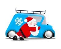 Jultomten som skjuter en blå mini- bil Royaltyfria Bilder