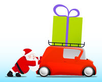 Jultomten som skjuter en röd mini- bil med en gåvaask Arkivfoto