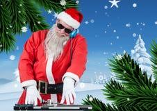 Jultomten som spelar dj i disko Arkivbilder
