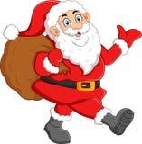 Jultomten som vinkar och rymmer säcken Royaltyfri Bild