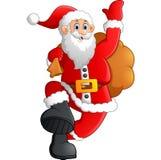 Jultomten som vinkar och rymmer säcken Arkivbilder
